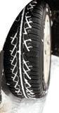 冬天在雪的汽车轮胎 免版税库存图片