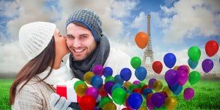 冬天夫妇的综合图象拿着礼物的 免版税图库摄影