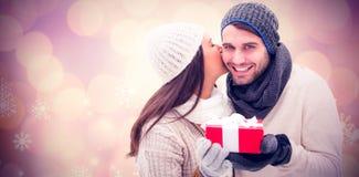 冬天夫妇的综合图象拿着礼物的 库存图片