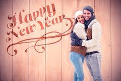 年轻冬天夫妇的综合图象 免版税库存图片