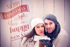 年轻冬天夫妇的综合图象 图库摄影