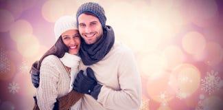 年轻冬天夫妇的综合图象 库存照片