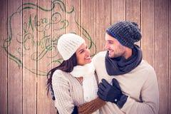 年轻冬天夫妇的综合图象 免版税图库摄影
