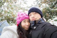 年轻冬天夫妇自已 图库摄影