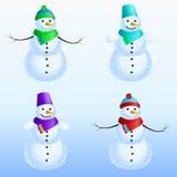 冬天套四个雪人 库存照片