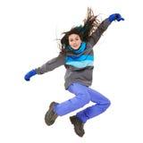 冬天妇女跳跃 免版税库存图片