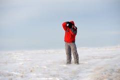 冬天山的摄影师 库存照片