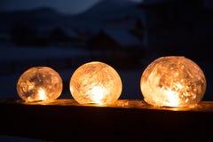 冬天工艺:冰有一个蜡烛的闪烁的火的灯笼 免版税库存照片