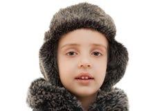 冬天帽子毛皮敞篷孩子被隔绝的画象特写镜头 免版税库存图片