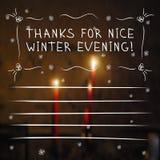 冬天感谢与蜡烛的卡片在背景 免版税库存照片