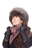 冬天成套装备的端庄的妇女 免版税库存图片