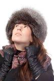 冬天成套装备的端庄的妇女 免版税图库摄影