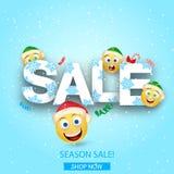 冬天折扣 用在白色背景的戴西装饰的季节性sale.green标签 与愉快的眼睛的微笑的黄色球和在新年` s盖帽的红润面颊 免版税库存图片