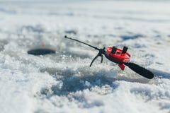 冬天捕鱼设备 库存图片