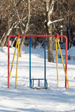 冬天操场Swingset设备 免版税库存图片