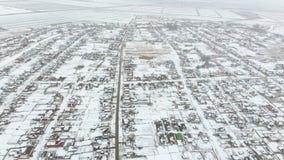 冬天村庄的顶视图 农村解决用雪报道 雪和冬天在村庄 库存图片
