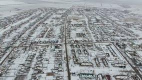 冬天村庄的顶视图 农村解决用雪报道 雪和冬天在村庄 免版税图库摄影