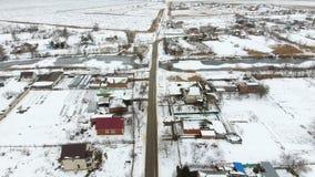 冬天村庄的顶视图 农村解决用雪报道 雪和冬天在村庄 库存照片