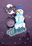冬天海报飞行物卡片与一个雪人的盖子设计与羊毛帽子图象和冬天风景 库存照片