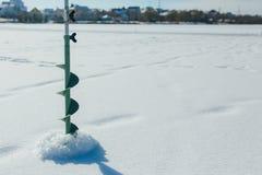 冬天渔的捕鱼装置 免版税库存图片