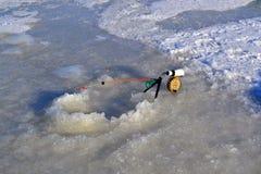 冬天渔的钓鱼竿 免版税图库摄影