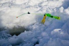 冬天渔的钓鱼竿 库存照片