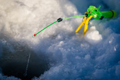 冬天渔的钓鱼竿 库存图片
