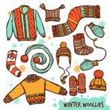 冬天温暖的被编织的衣裳彩色组 库存图片