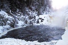 冬天瀑布Kivach 库存照片