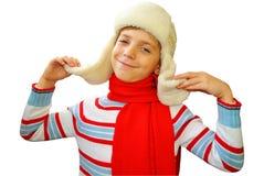冬天盖帽的俏丽的男孩 免版税库存照片