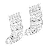 冬天编织了礼物的种族袜子从在zentangle猪圈的圣诞老人 免版税图库摄影