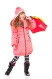 冬天衣物的小女孩 免版税图库摄影