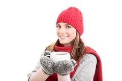 冬天衣裳和热的茶 免版税库存照片