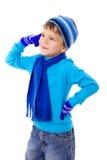 冬天衣裳的体贴的男孩 免版税库存图片