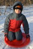 冬天衣裳的男孩 免版税库存图片