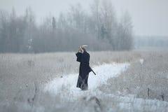 冬天训练的东方武术战士 图库摄影