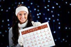 冬天:拿着12月2015日历 免版税库存照片
