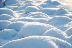 冬天:雪土墩表面  库存图片