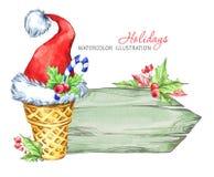 冬天水彩贺卡,与奶蛋烘饼锥体和圣诞老人帽子的木制框架 库存图片
