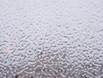 冰和下落在窗口 库存图片