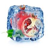 冰和石榴 免版税库存图片