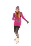 滑冰在冰的可爱的妇女 免版税库存图片
