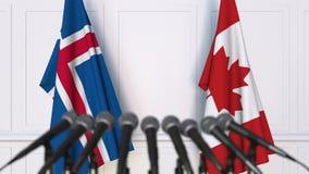 冰岛和加拿大的旗子在国际会议或交涉新闻招待会 影视素材