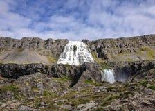 冰岛的西峡湾区的壮观的Dynjandi瀑布珠宝晴朗的天气和天空蔚蓝的 免版税库存图片