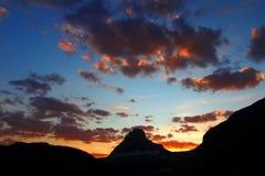 冰川国家公园山日落 图库摄影