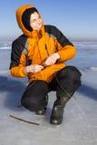 冰捕鱼。 库存照片