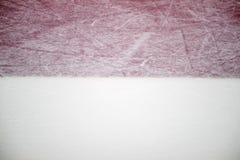 冰球场红色标号特写镜头,冬季体育背景 免版税库存图片