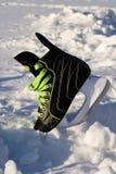 冰鞋随风飘飞的雪 库存照片