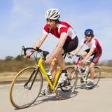 冲刺的骑自行车者 库存图片