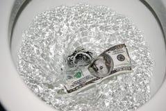 冲洗的货币 免版税库存照片
